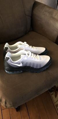 Pair of white-and-gray nike running shoes