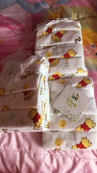 3 - 4 pack Winnie the Pooh receiving blankets - brand new Surrey, V3W