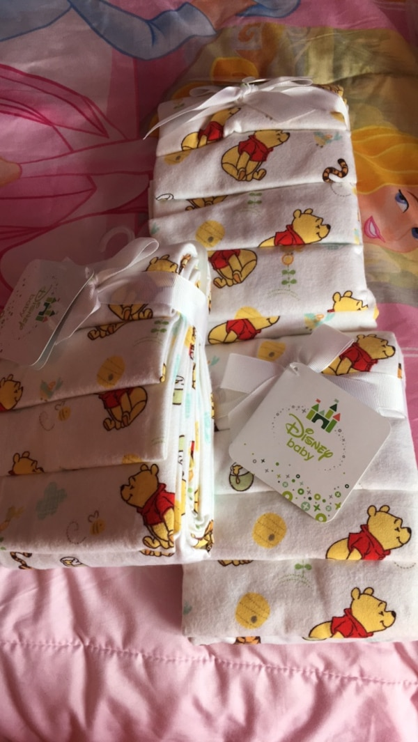 3 - 4 pack Winnie the Pooh receiving blankets - brand new
