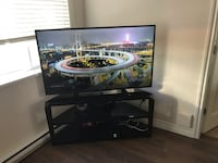 black wooden TV stand with flat screen TV Richmond