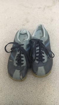 Pair of gray-and-black low top sneakers