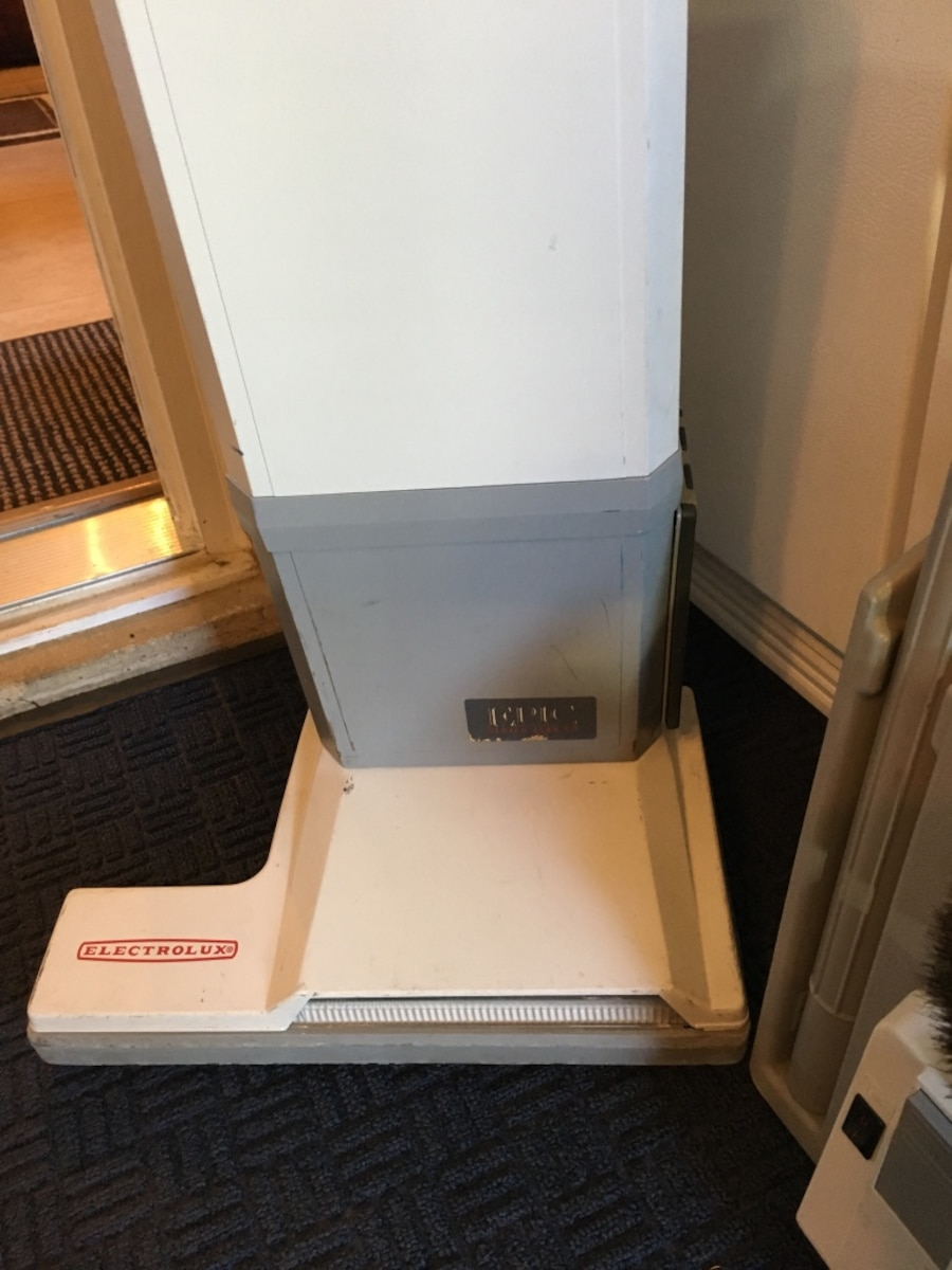 white Electrolux carpet extractor