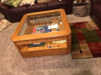 Brown wooden framed glass top coffee table Accokeek, 20607