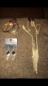 Gold and black bracelet, earrings and necklace