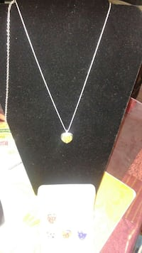 gold-colored heart-pendant necklace