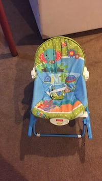 infant's blue and green Fisher Price bouncer rocker