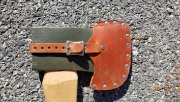 Wood handle axe with leather sheath