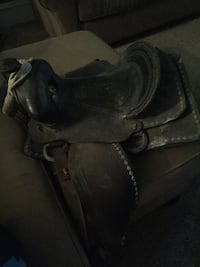 Black leather horse saddle 134 mi