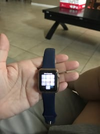 Rose gold apple watch with blue sports band and extra bands null