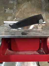 grey and red table saw