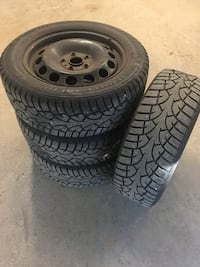 4 Used Studded snow tires w/ steel rims North Yarmouth