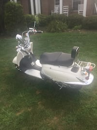 white and black motor scooter Bluemont, 20135