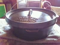 Cast Iron pot and it has a cover for it. Augusta, 30904