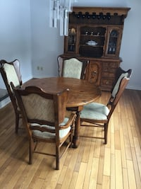 Solid wood dining table, 6 chairs, 2 additional leafs, buffet and hutch with 2 glass doors.  Also has a side server with black leather top. Innisfil, L9S 2N4