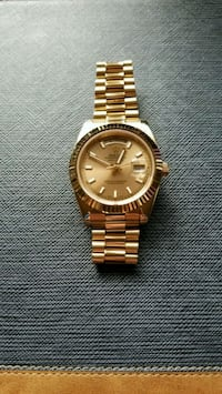 round gold Rolex analog watch with link bracelet Brentwood, 94513