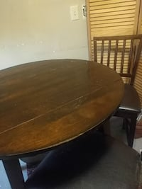 Brown round table with colapsible edges
