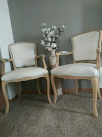 two white padded armchairs with brown wooden frame 1463 mi