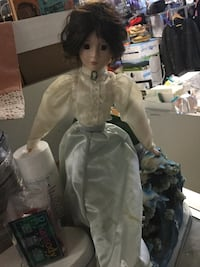 girl with white and gray dressed doll Winnipeg, R3G 0A9