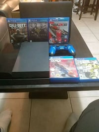 black Sony PS4 console with controller and games Brampton, L6V 3X1