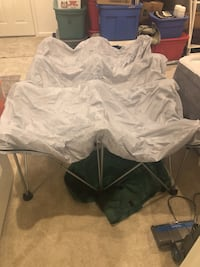 Air mattress bed frame. Great for camping, opens up to hold either a full size or queen size air mattress. Stands 2 feet off the ground and then folds up and cones in a storage bag Baltimore, 21236