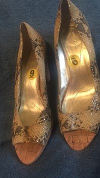 pair of brown Anne Klein snakeskin print peep toe pumps