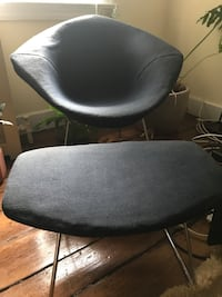 silver framed black padded glider chair Washington, 20006