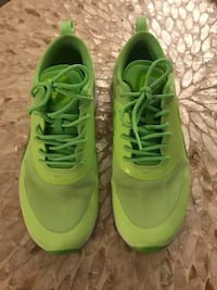 pair of green Nike running shoes San Diego, 92109