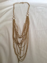 gold-colored rope accent necklace