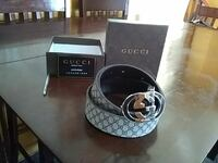 black and gray Gucci belt with box