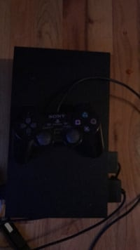 black Sony PS3 game console with controller