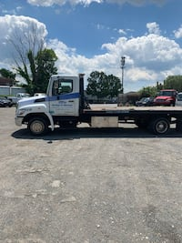 hino - rollback tow truck  - 2013 Sterling