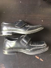 Pair of black leather dress shoes for boys  Gatineau, J9J