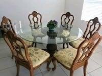 Formal round glass dining table Port St. Lucie