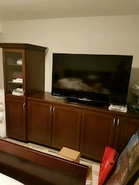 flat screen television with brown wooden TV hutch Toronto, M4R 1M5