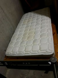 white Twin mattress with brown wooden bed frame Toronto, M5A 3X2