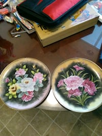 two white and pink floral ceramic plates