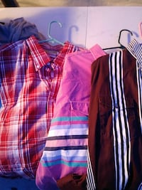 three assorted-color shirts