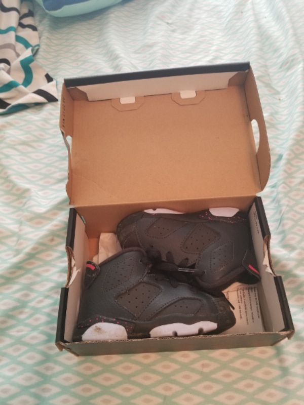 pair of black Air Jordan 8's in box