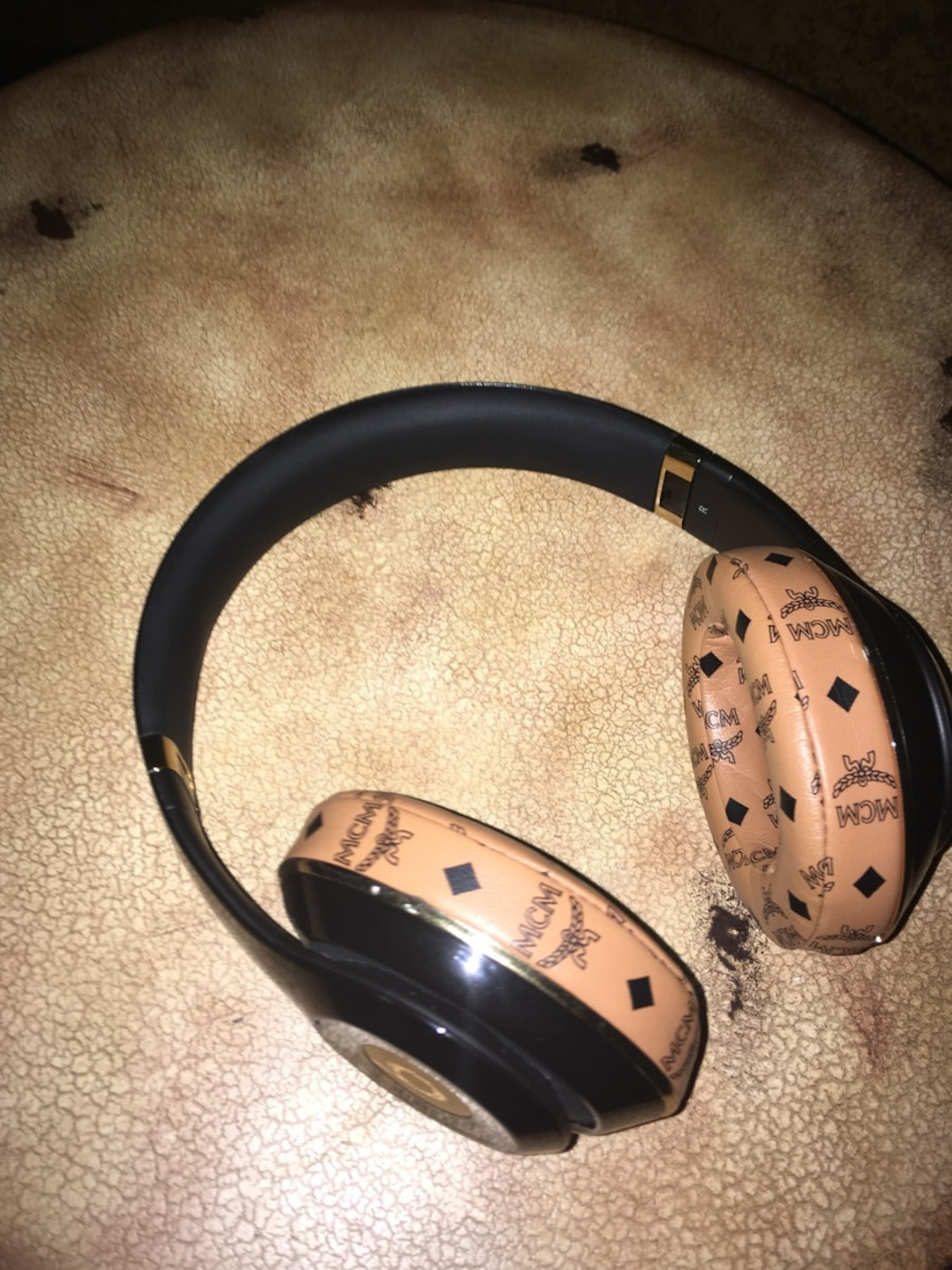 Black and gold Beats By Dr. Dre collab MCM cordless headphones - TX