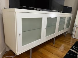 IKEA cabinet with glass doors and glass shelves