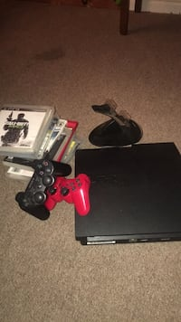 black Sony PS3 slim console with controllers and game cases 37 mi