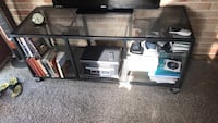 Black metal framed glass top tv stand Room and Board