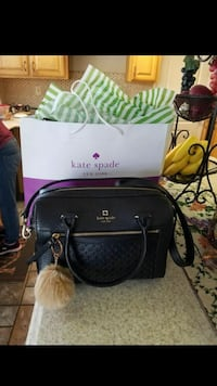 black Kate Spade leather 2-way handbag and purple and white tote bag