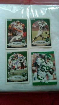 four baseball player trading cards 567 mi