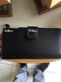 Black leather Brand new M badged wallet
