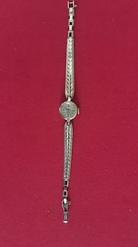 round silver analog watch with silver link bracelet Richmond Hill, L4E 4W5