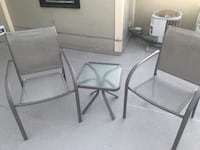 Two gray metal framed white padded armchairs