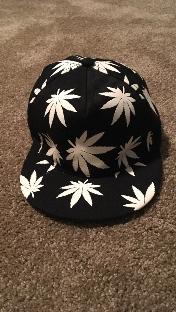 39220fd0d8cfc Used black and white glow in the dark cannabis leaf print cap for sale ...