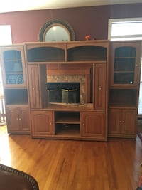 Brown wooden tv hutch with flat screen television Fayetteville, 72701