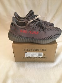 black-and-gray Adidas Yeezy Boost 350 V2 shoes with box